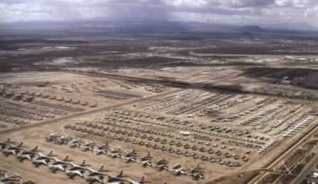 Aerial view of Davis-Monthan Air Force Base and AMARG airplane boneyard in Tucson, Arizona with rows of C-141 Starlifters, B-1B Lancers and F-111 Aardvarks in storage