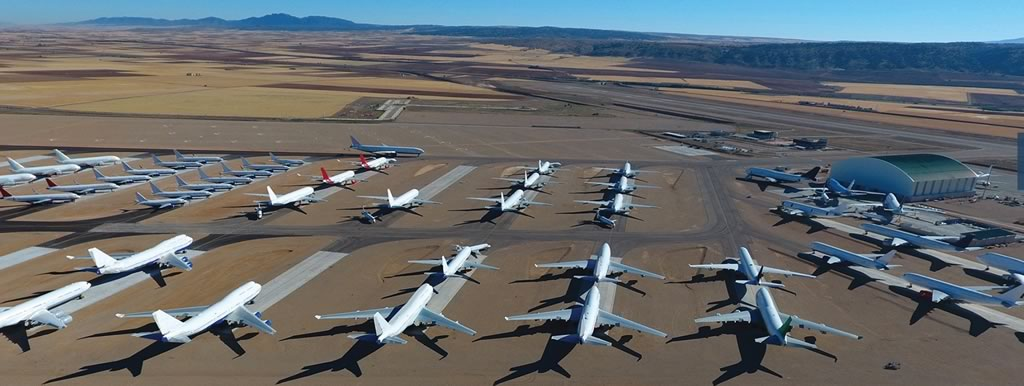 Overhead view of dozens of airliners parked at the TARMAC Aerosave facility at the Teruel Airport