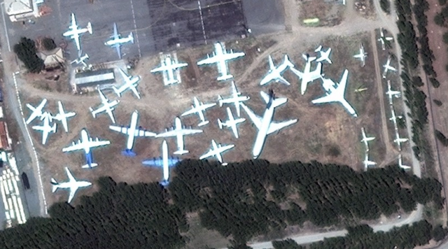 Aerial view of airplane boneyard at Manas International Airport in Kyrgyzstan